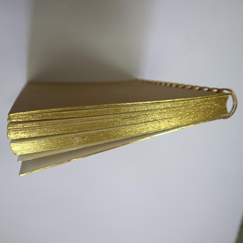 สมุดปกม้วนขดทองปั๊มลวดลายย้อนยุค